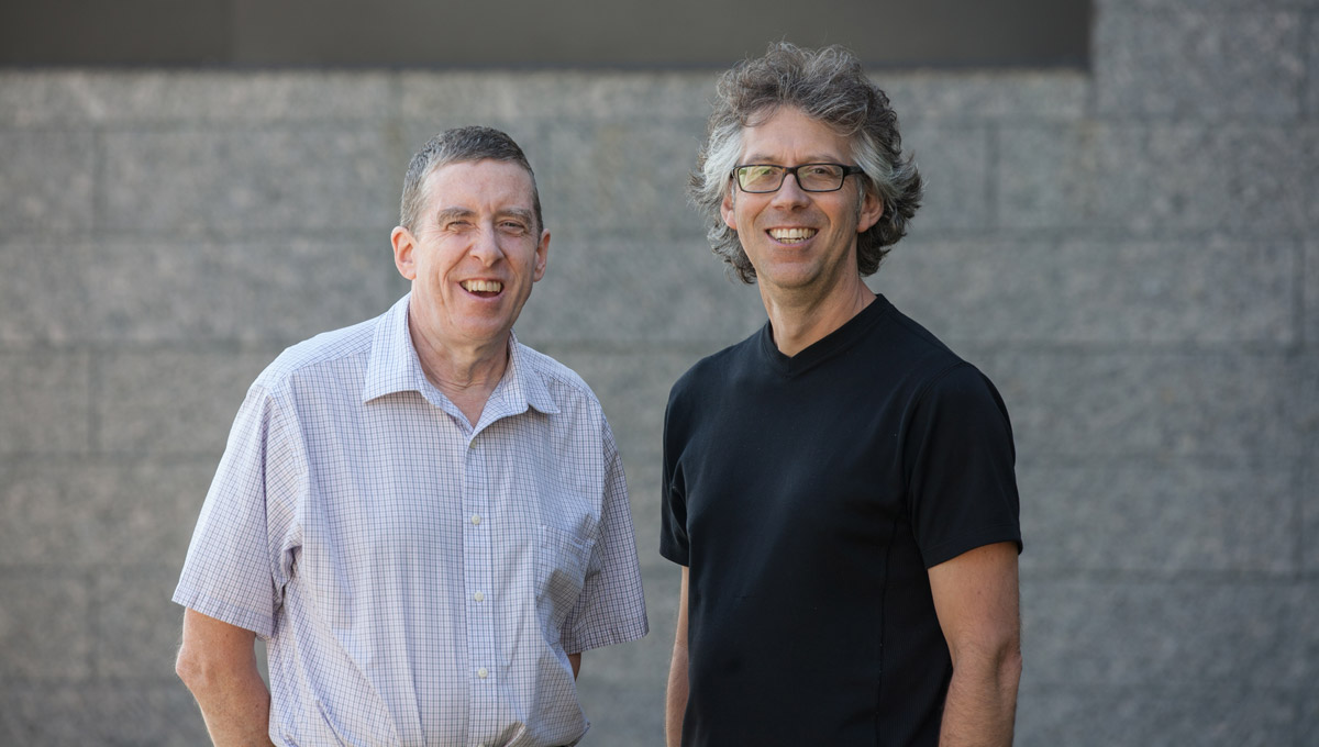Prof. Paul Johns and OMPI Executive Director Malcolm McEwen stand together outdoors.