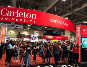 Scenes from Carleton's booth at the annual Ontario Universities' Fair in September 2019.