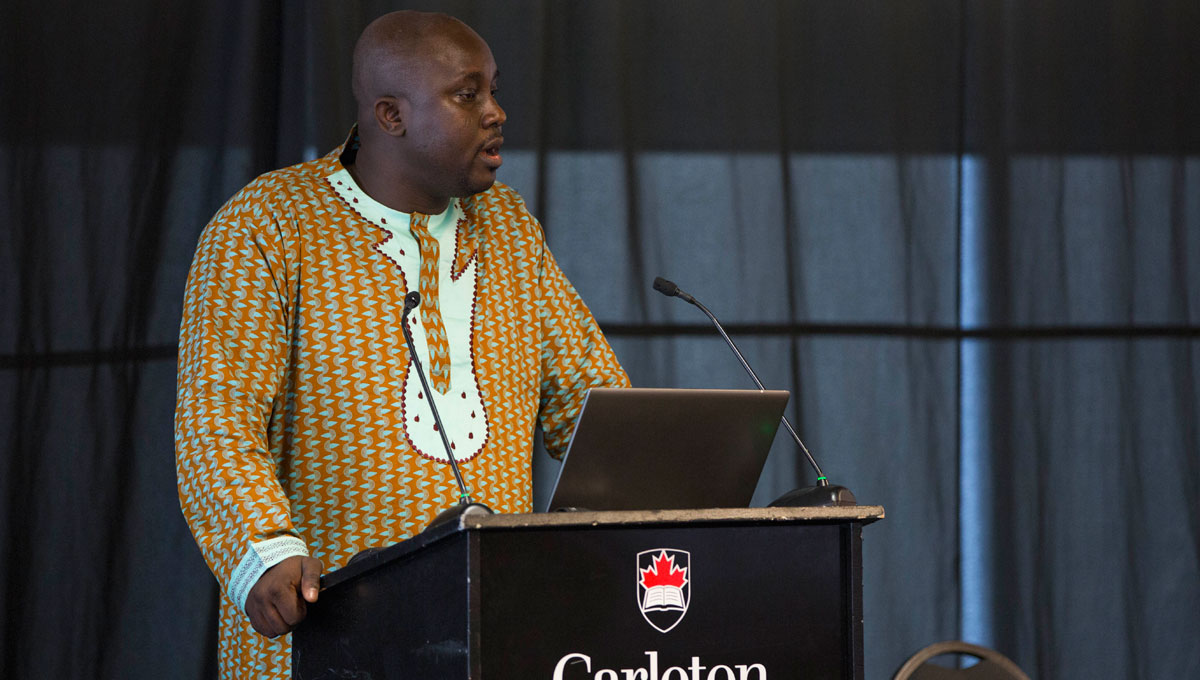Prof. Adesanmi speaks at the From Climate Change to Environmental Sustainability conference in 2016