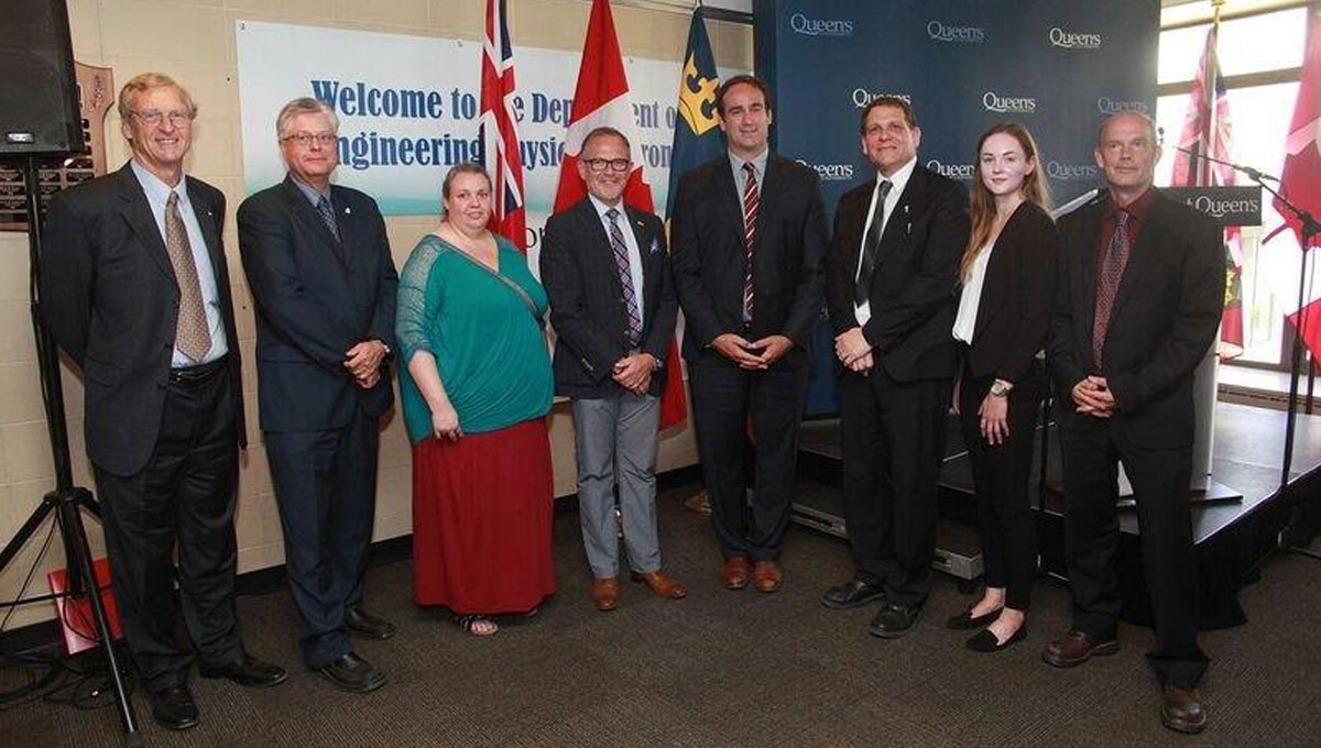 Carleton's David Sinclair (left) attends a celebration of the new federal funding at Queen's University.