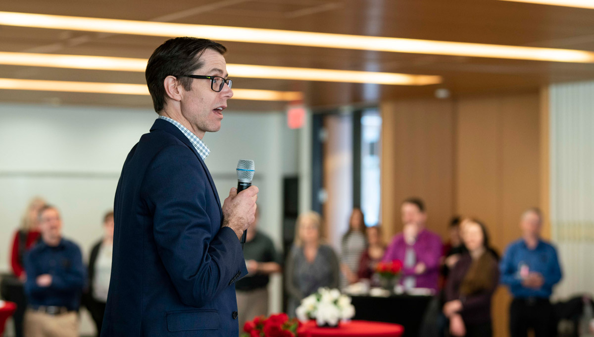 Carleton's Patrick Lyons speaks at an event launching Teaching and Learning Services' collection of 67 short stories from Carleton's faculty members and staff in February 2019.