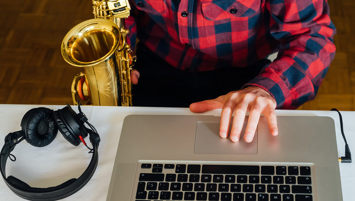 A saxaphone, laptop and headphones