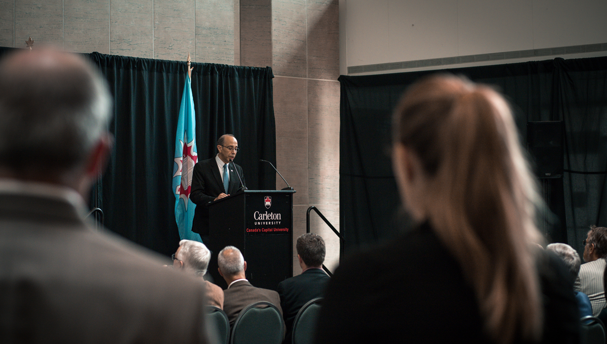 Rafik Goubran, vice-president (Research and International) speaks at a podium during an announcement of Transport Canada funding for Carleton research projects.