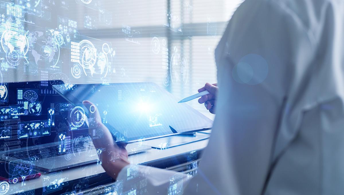 A researcher using an iPad