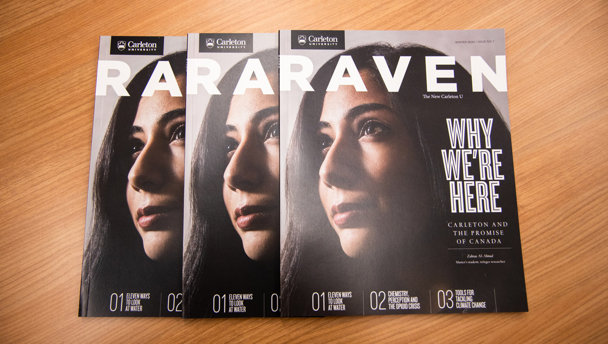 Three copies of the Raven Magazine spread out on a table.