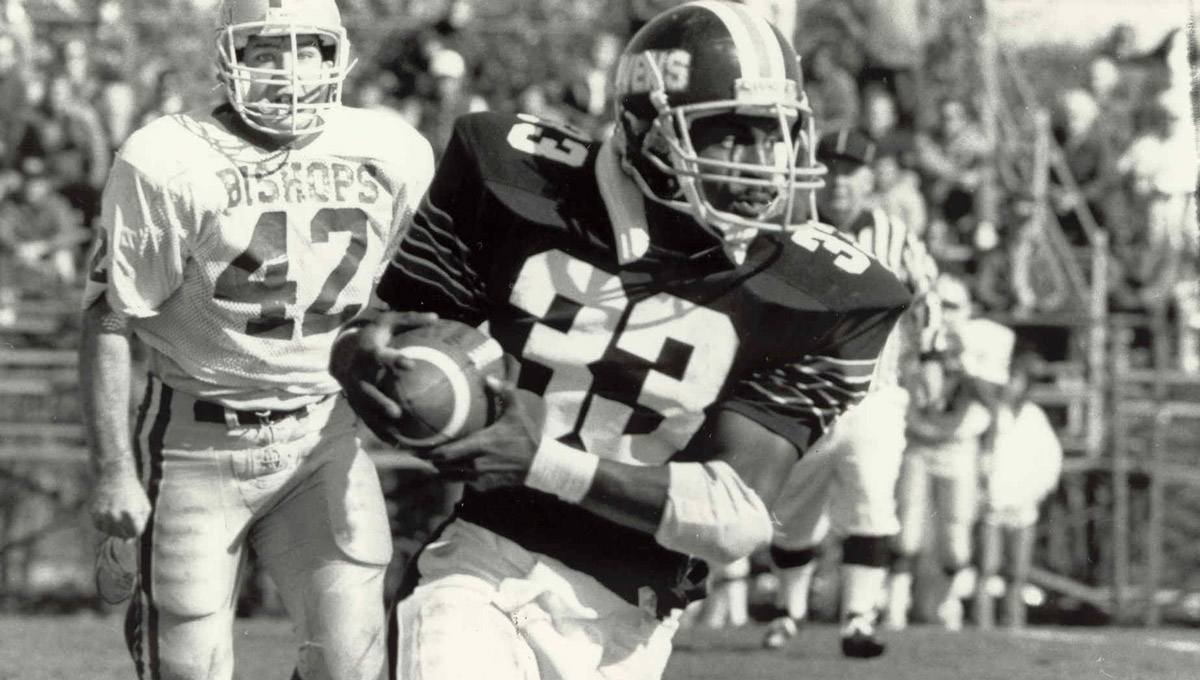 A black and white photo of a Carleton Raven rushing during a game.