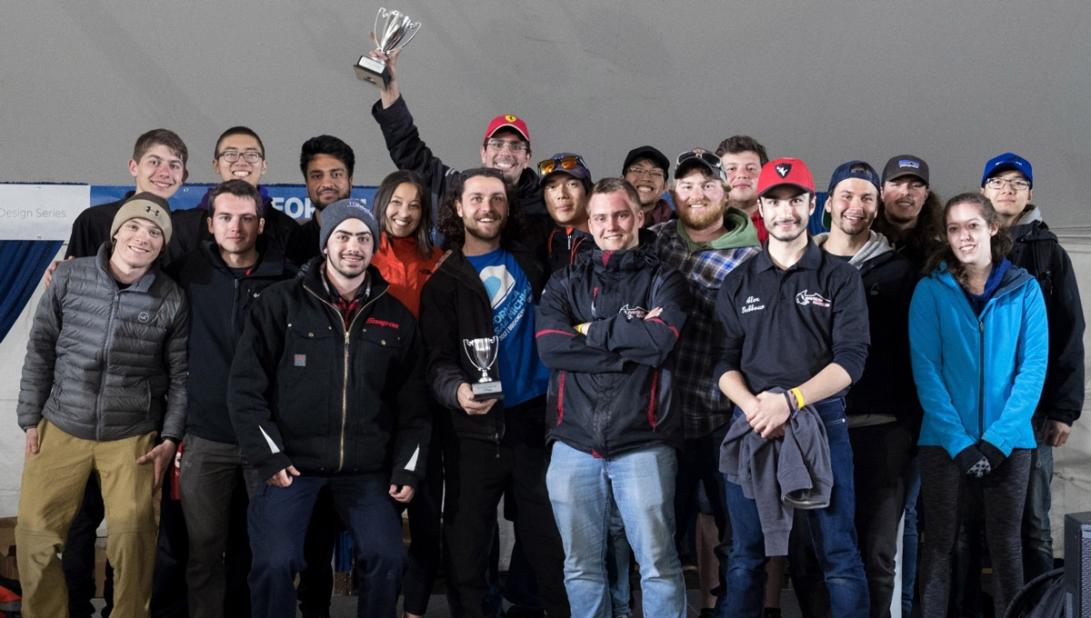 The Carleton University Ravens Racing team poses together with their trophy.