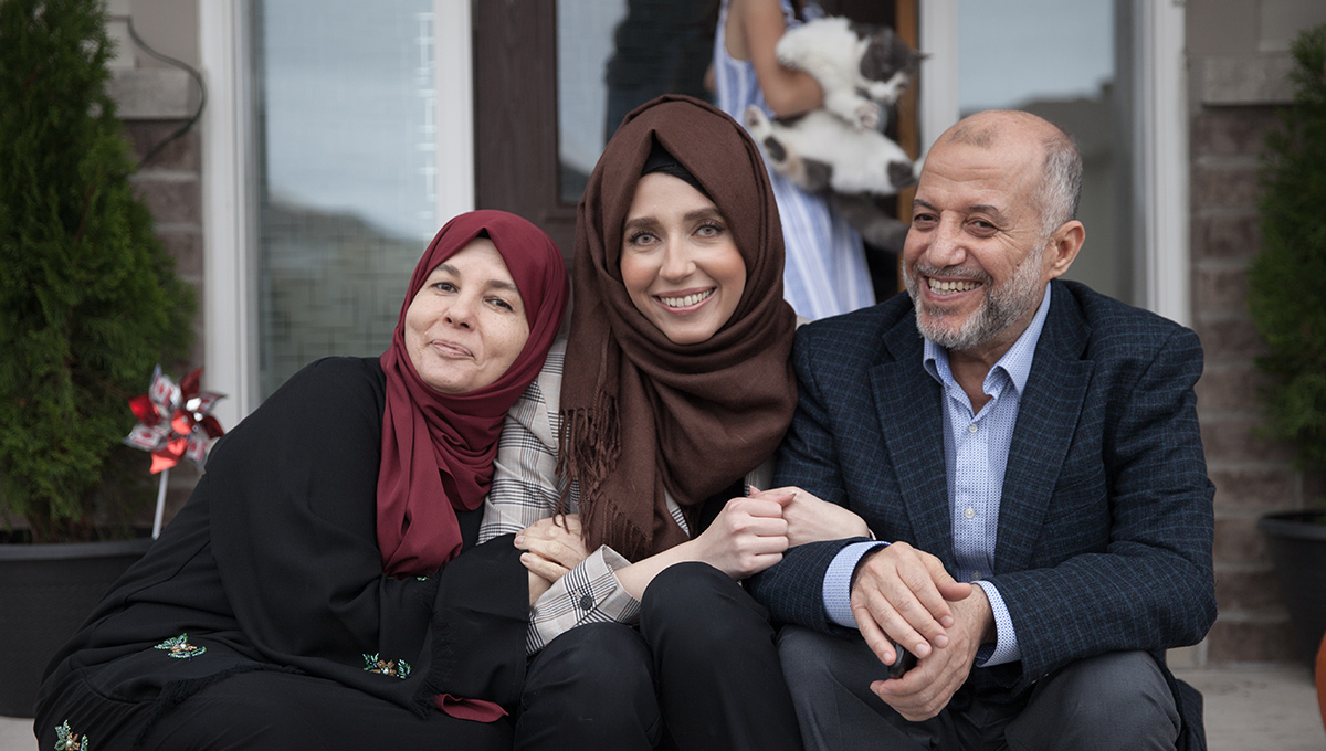Rawan Alkurd with her parents