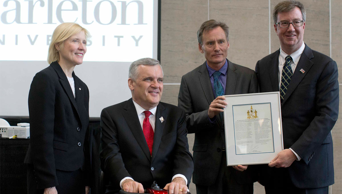 (From left to right) Carleton University president and vice-chancellor Dr. Roseann O'Reilly Runte, READ initiative's honorary patron and former Ontario lieutenant-governor David Onley, director of the Paul Menton Centre for Students with Disabilities Larry McCloskey and Ottawa Mayor Jim Watson at the Attendant Care Services 25th Anniversary, May 2013
