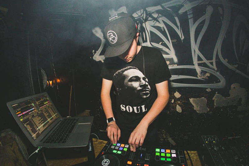 Photo of Nicholas Osborne working as a DJ in a nightclub