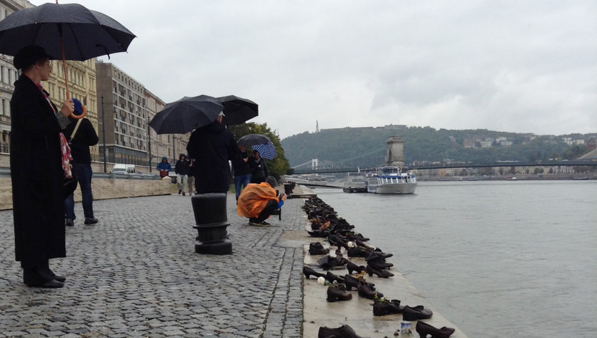 Shoes on the Danube Bank is a memorial in Budapest to honor the people (mostly Jews) who were killed by the fascist Arrow Cross militiamen in Budapest during World War II. Jewish people, like Morrison's great aunt, were marched away to the edge of the Danube, methodically lined up and shot.
