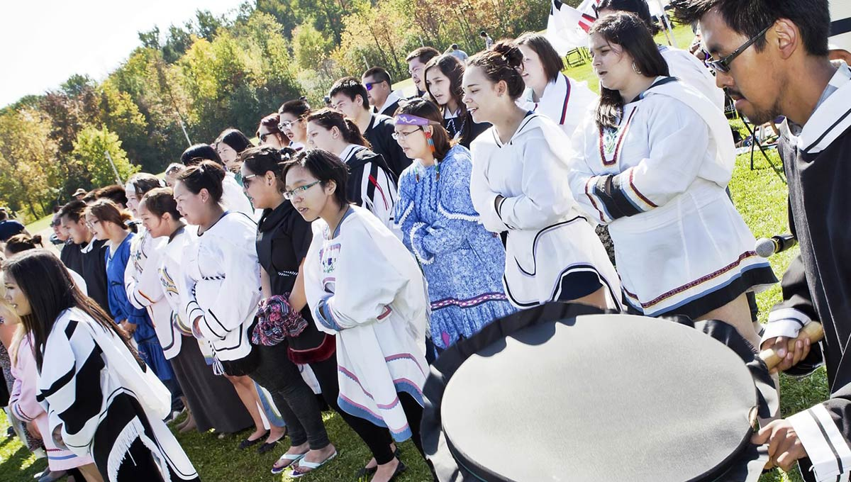 Truth and Reconciliation: Indigenous Students in traditional clothing