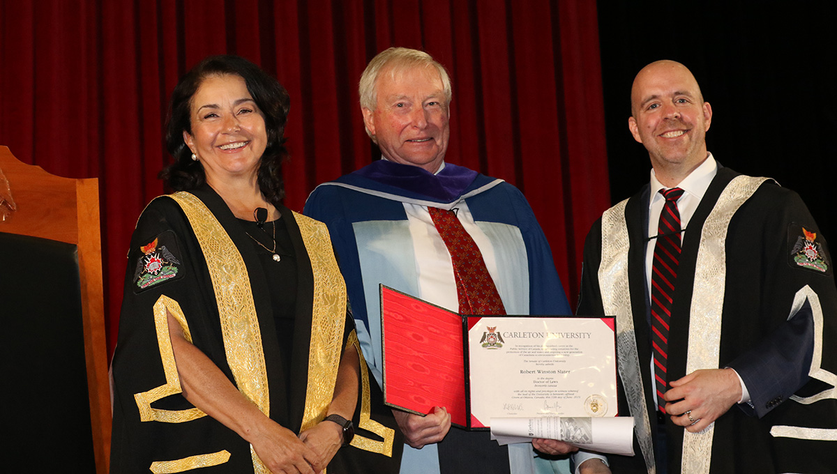 Prof. Robert Slater (middle) with Chancellor Yaprak Baltacıoğlu and President Benoit-Antoine Bacon