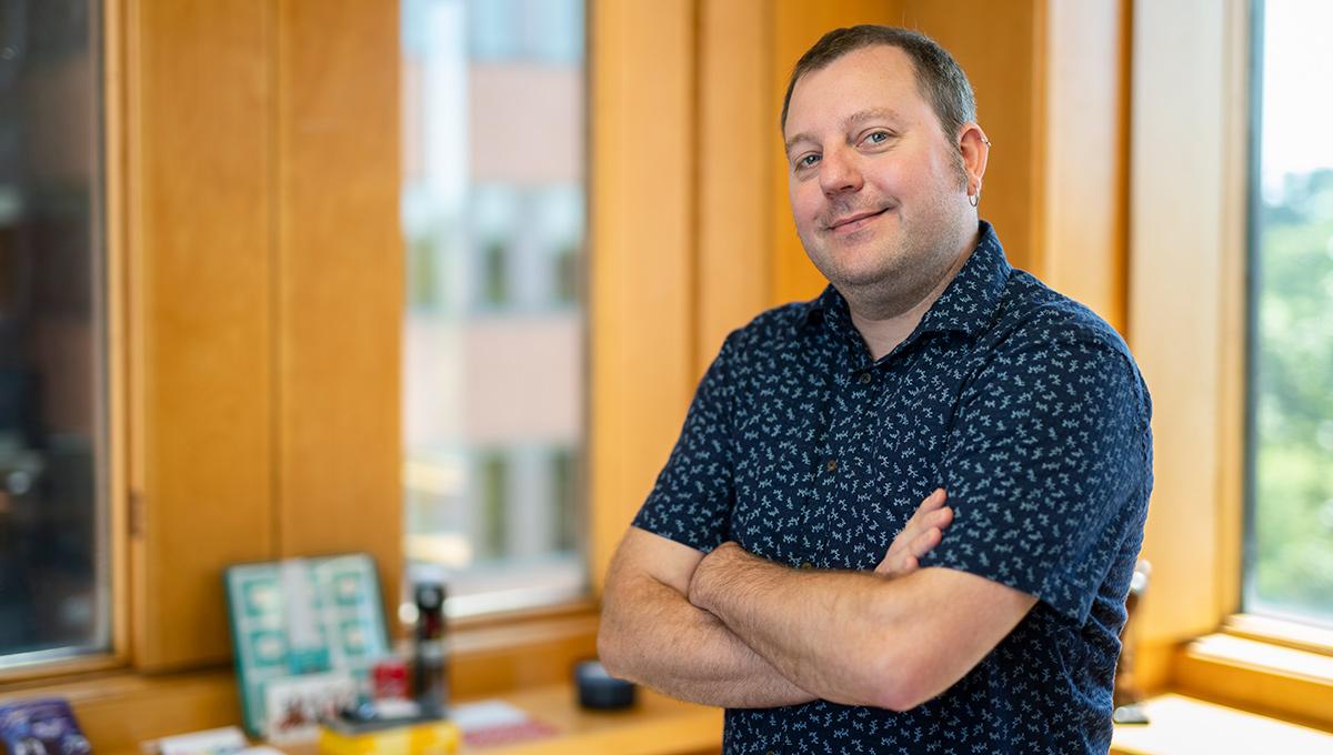 Prof. John Zelenski poses in his office.