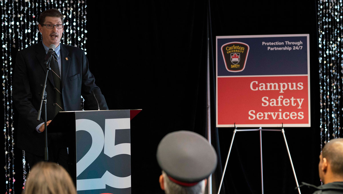 Brian Billings speaks at a podium. Carleton's special constables marked their 25th anniversary in Oct. 2018 with a celebration that recognized its partnership with the Ottawa Police Service.