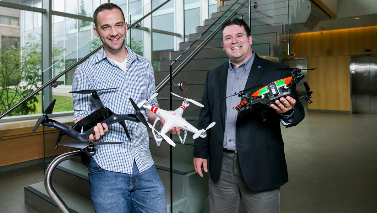 Darren Penley, left, and Prof. Jeremy Laliberté are utilizing drone technology to enhance their research at Carleton