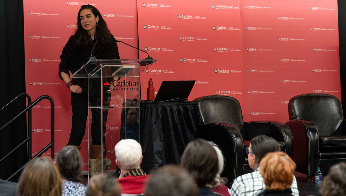 Tanya Talaga speaks about Tanya Talaga on Seven Fallen Feathers in front of a large crowd at the annual Kesterton Lecture in February 2019.