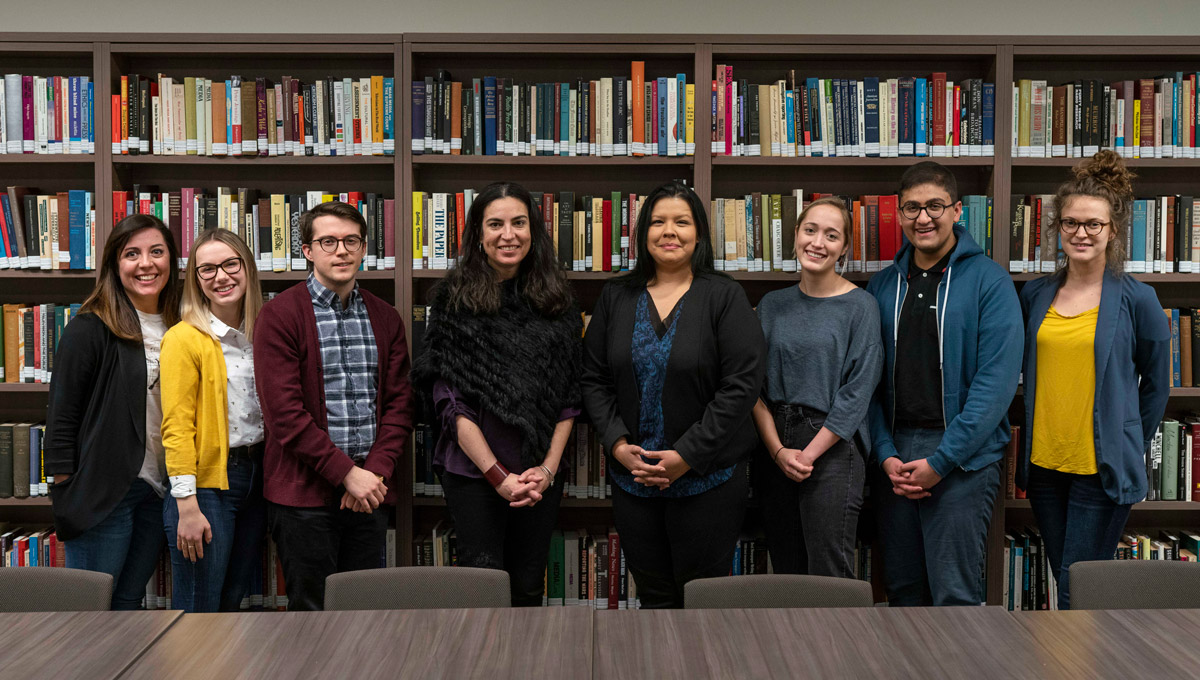 Tanya Talaga, APTN's Francine Compton and student journalists. Tanya Talaga Seven Fallen Feathers in front of a large crowd at the annual Kesterton Lecture in February 2019.