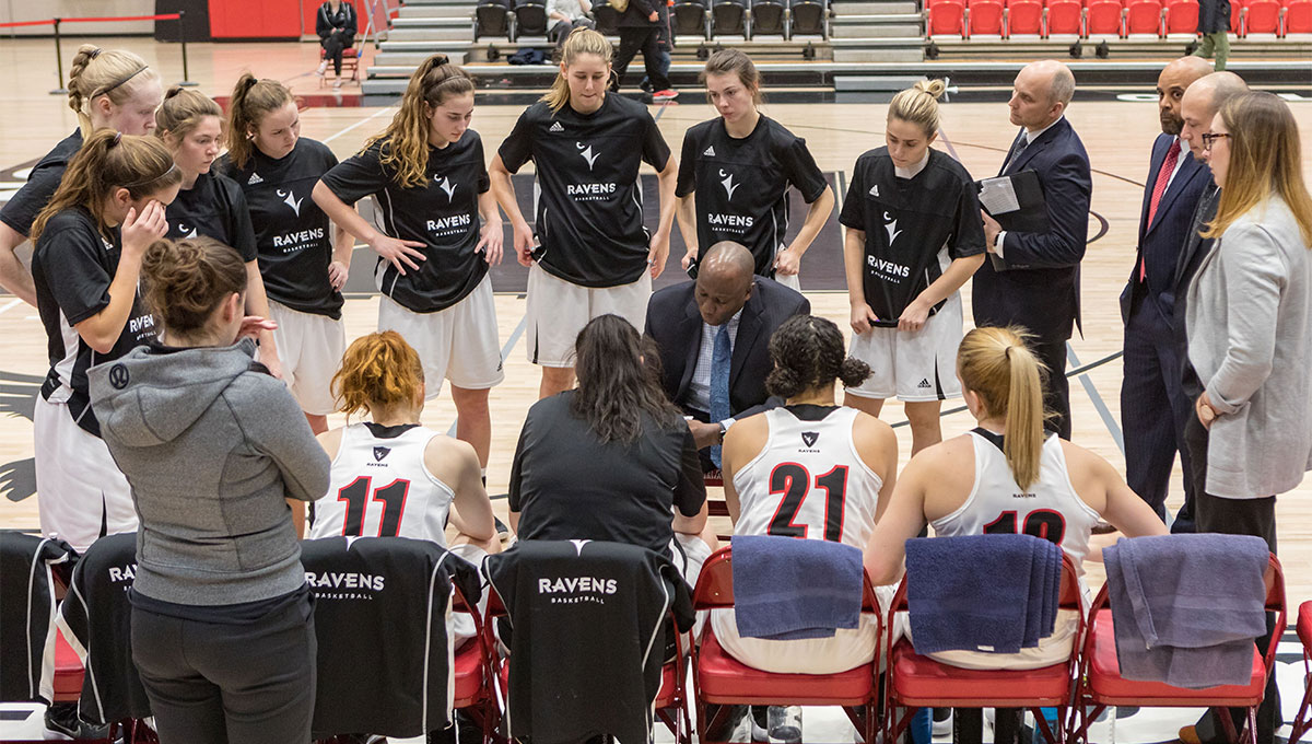 Women in Sport: The Ravens women's basketball team gathers around coach Taffe Charles
