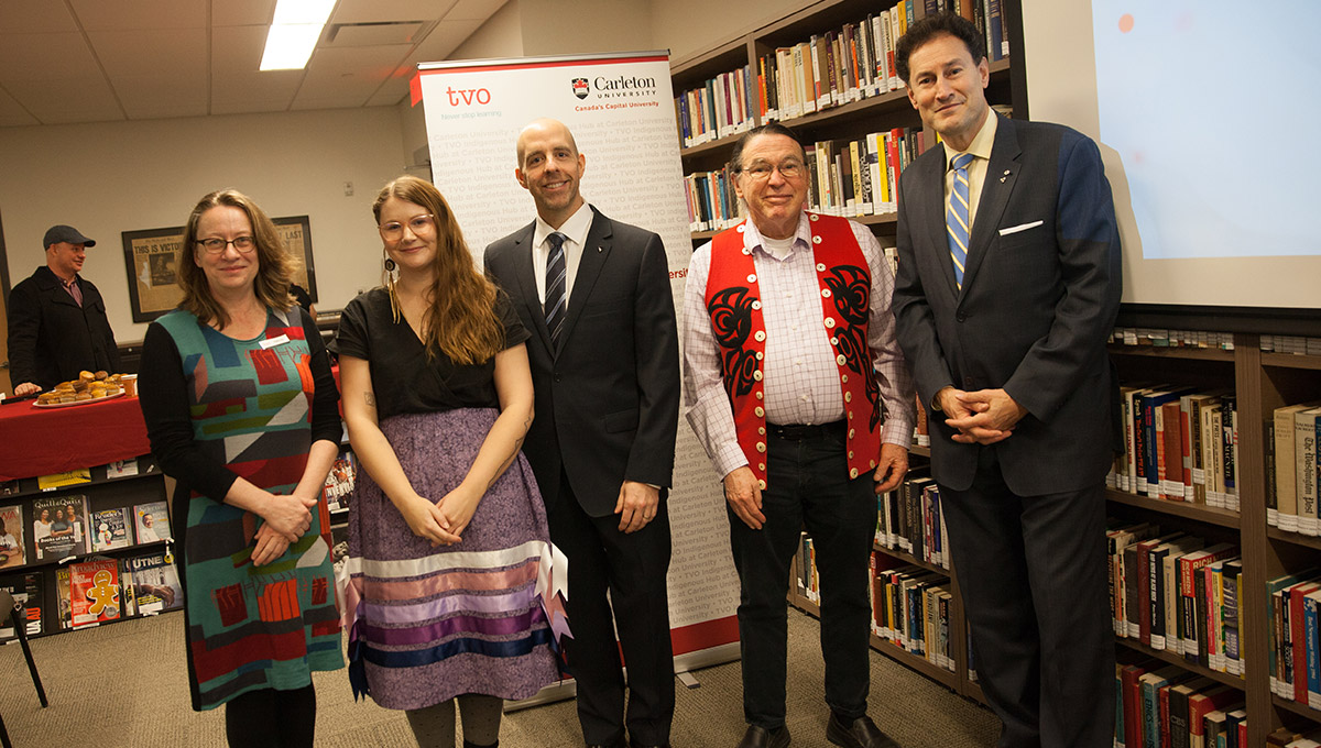 Photo of Kathy Vey, Shelby Lisk, Benoit-Antoine Bacon, John Kelly and Steve Paikin, posing together after the launch event for the new TVO Indigenous Hub at Carleton University.
