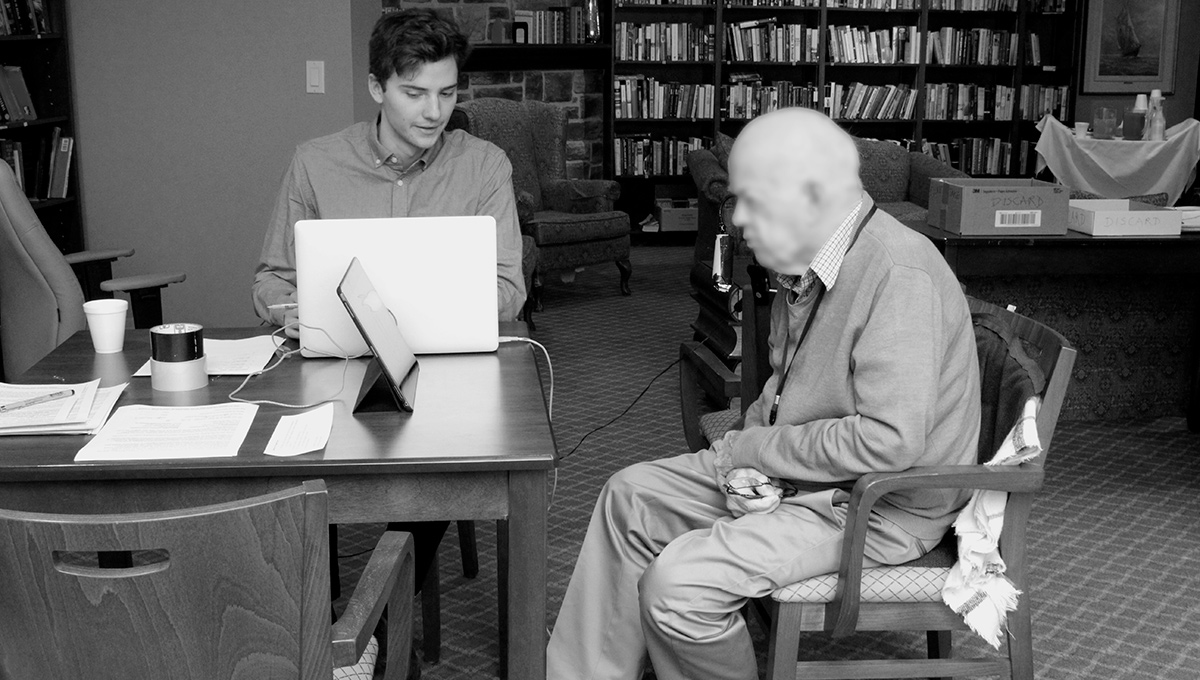 Rob Shudra interviews a senior citizen at the Chartwell Retirement Residences.