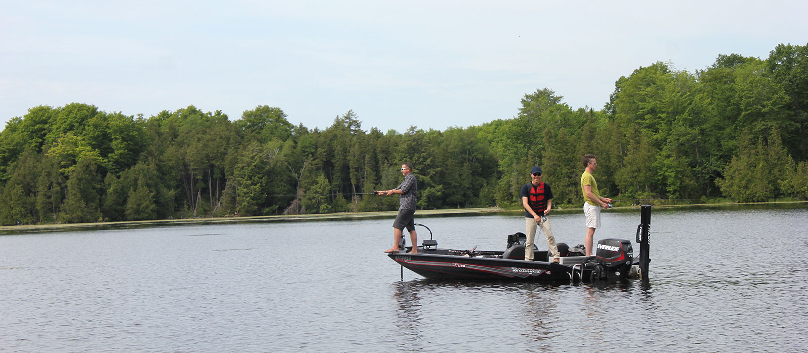 Photo of Carleton University students and their professors conducting research on Big Rideau Lake