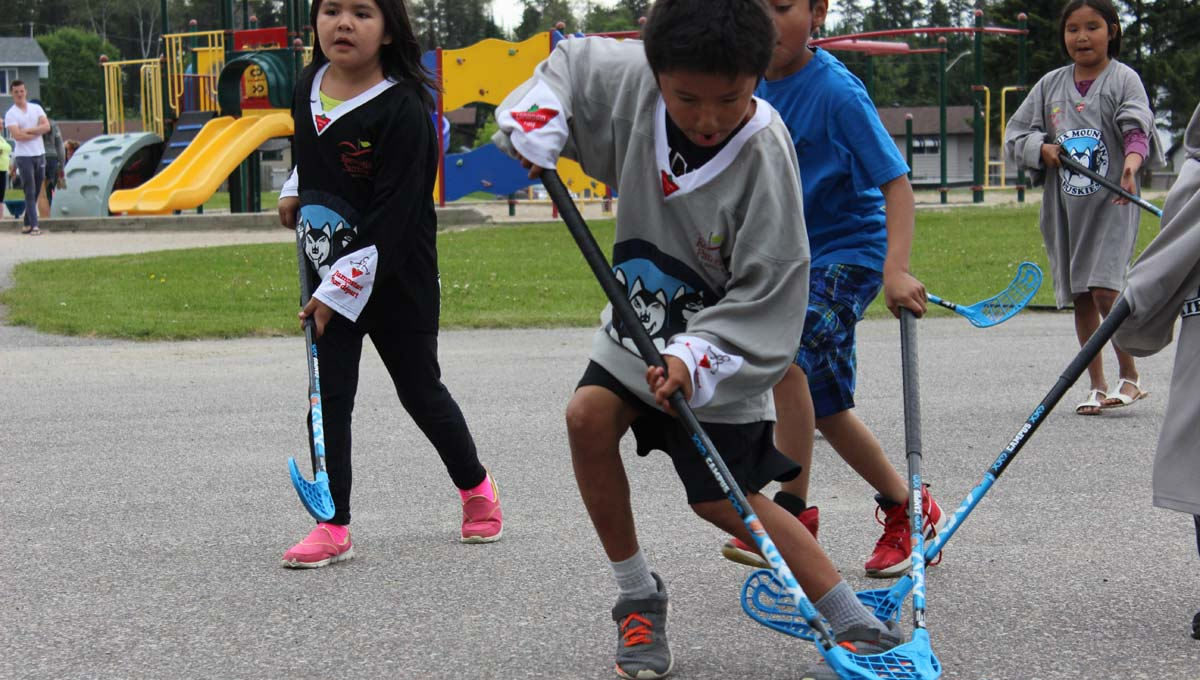 Indigenous Communities: Children and youth play sports outdoors.